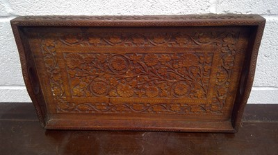 Lot 19 - An Indian carved hardwood butler's tray,...