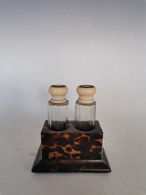 Lot 14 - Two ivory and tortoiseshell glass perfume...