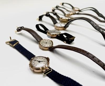 Lot 38 - Eight ladies gold cased wristwatches. Phillip...