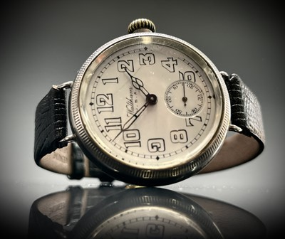 Lot 8 - A Waltham silver trench cased wristwatch the...