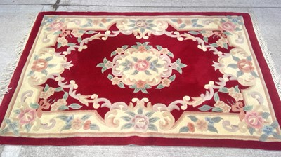 Lot 66 - A red ground rug, 197 x 120cm
