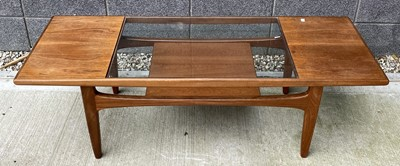 Lot 67 - A G-plan teak coffee table with glass insert,...