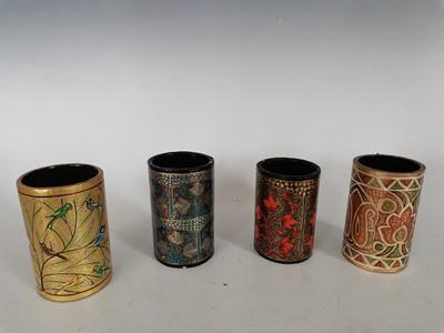 Lot 93 - Four Indian decorated papier mache pen holders.