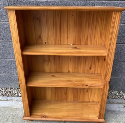 Lot 75 - A modern pine open bookcase, height 109cm...