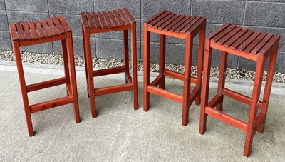 Lot 84 - Four red-stained stools height 71cm width 34cm...