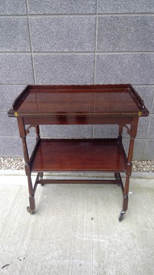 Lot 88 - A mahogany drinks trolley with twist top card...