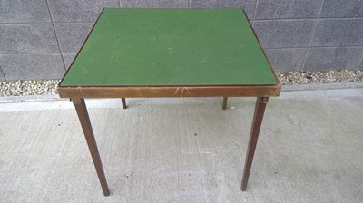 Lot 65 - A Vono foldaway card table with a green baize...