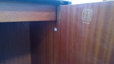 Lot 21 - A black G-Plan bedroom suite comprising, a...