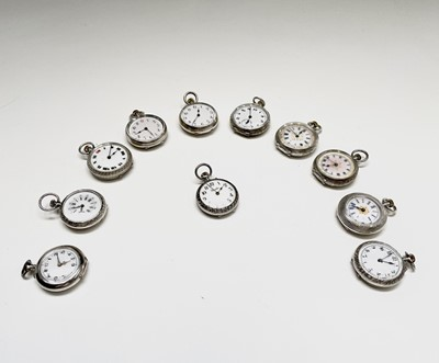 Lot 85 - Twelve small silver keyless fob watches, each...