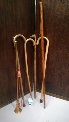 Lot 58 - A copper and brass coach horn, walking stick...