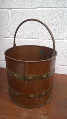 Lot 54 - A copper and brass bound coal bucket, height...
