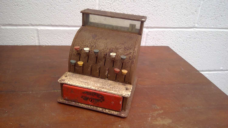 Lot 44 - A pre-decimal toy cash register, height 18.5cm.