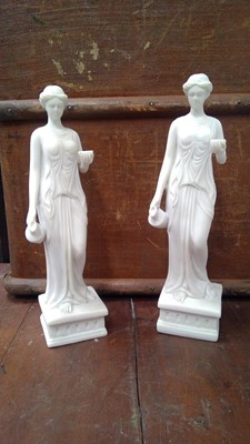 Lot 22 - A pair of composite figures of Hebe goddess of...