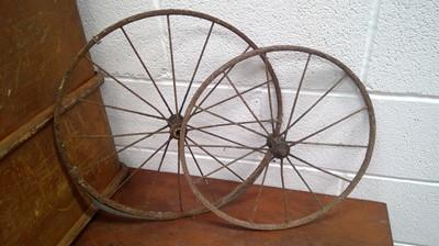 Lot 49 - Two vintage wheels, largest diameter 51cm.
