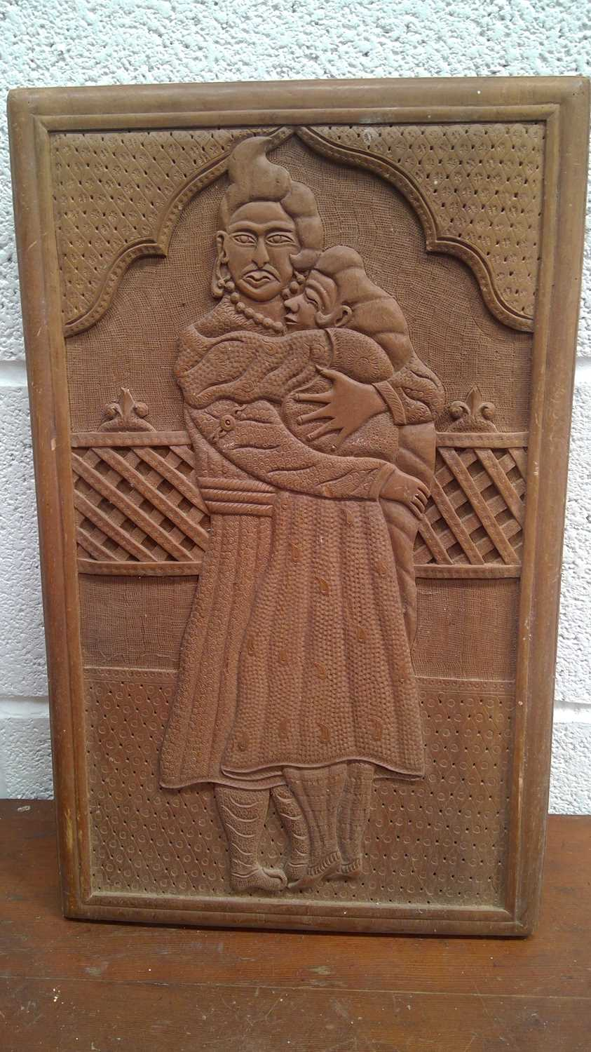 Lot 48 - Indian wood carved panel depicting a couple in...