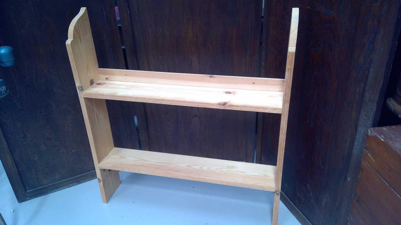 Lot 42 - A pine hanging shelf, height 87cm.