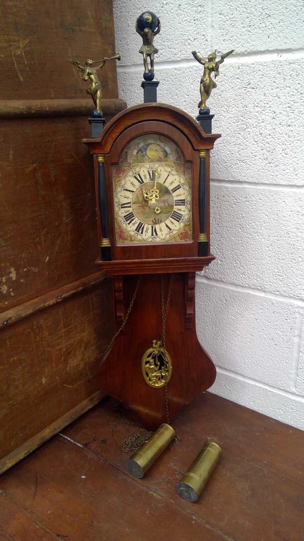 Lot 18 - A Warmink Dutch wall clock, height 67cm.