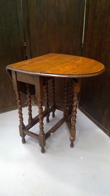 Lot 23 - A small oak gate leg table with barley twist...