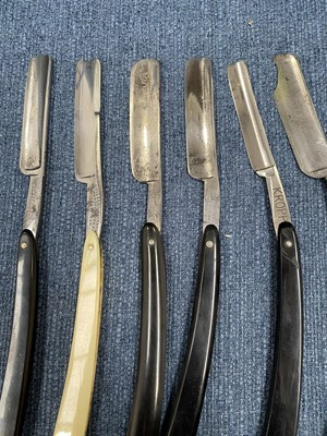 Lot 2 - Cut-throat razors in a fitted box, length 18.5cm.