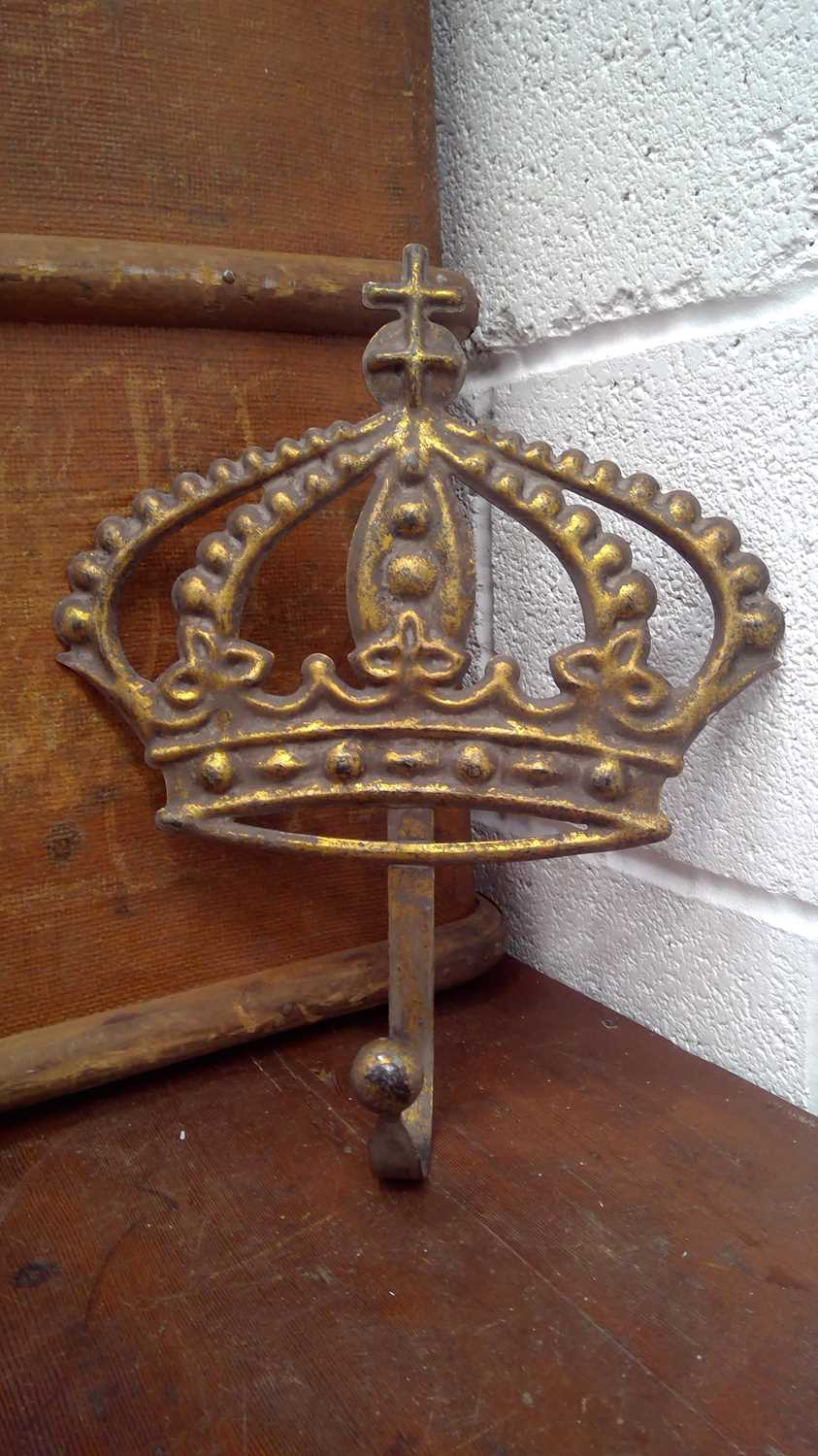 Lot 7 - A large gilt metal coat hook in the shape of a...