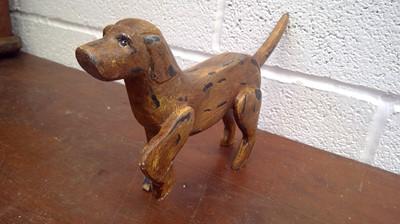 Lot 33 - Folk art painted wood carved model of a dog,...