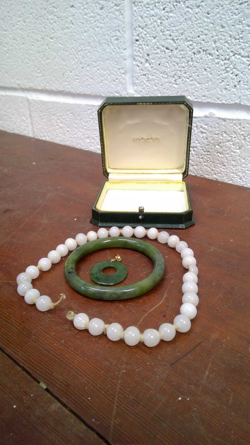 Lot 9 - White jade beads, spinach jade bangle, and a...