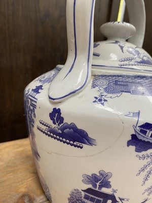 Lot 41 - A large blue and white willow pattern teapot,...