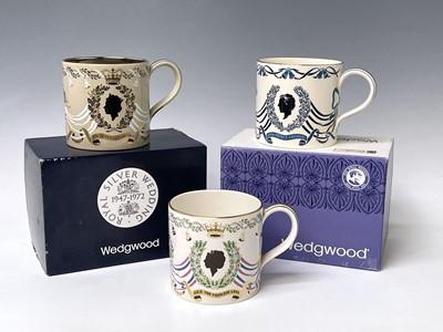 Lot 828 - Three Wedgwood commemorative mugs designed...