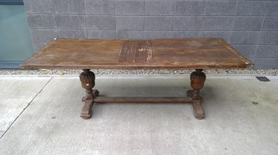 Lot 7 - An early 20th-century oak refectory table,...