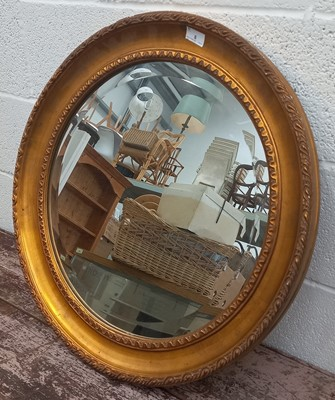 Lot 8 - A vintage-style gilt framed circular wall...
