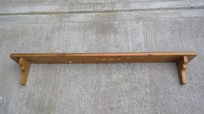 Lot 14 - A rustic pine shelf, width 137cm depth 15cm.
