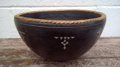 Lot 17 - A southeast Asian wood turned bowl with mother...