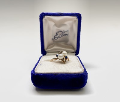 Lot 57 - A 10ct gold dress ring set with two pearls and...