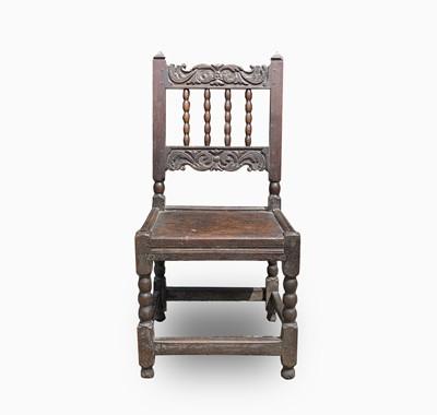 Lot 87 - A Charles II joined oak backstool,...