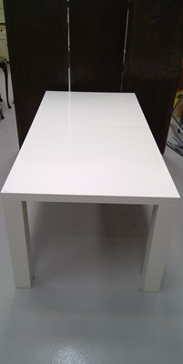 Lot 4 - A large stylish modern extending dining table...