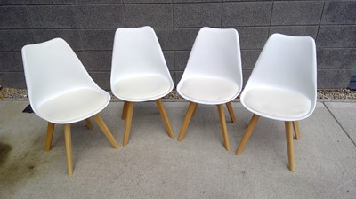 Lot 7 - A set of four stylish dining chairs with...