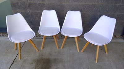 Lot 8 - A set of four stylish dining chairs with...