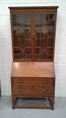 Lot 20 - A late Victorian oak bureau bookcase, the...