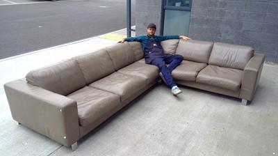 Lot 18 - An impressive six-seater L shaped leather sofa...