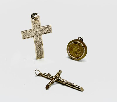 Lot 12 - A 9ct gold cross a 9ct gold crucifix and a...