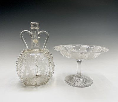Lot 801 - A 17th century style Dutch glass twin handled...