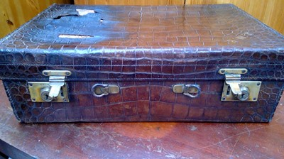Lot 7 - A vintage crocodile skin small suitcase, Army...