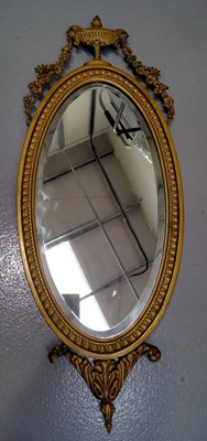 Lot 20 - An Adam style oval wall mirror with giltwood...