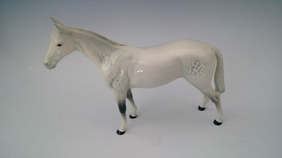 Lot 9 - A Beswick porcelain dappled grey horse. height...