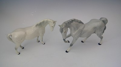 Lot 11 - A Beswick porcelain dappled grey horse, one...