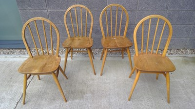 Lot 16 - Four Ercol stick back chairs.