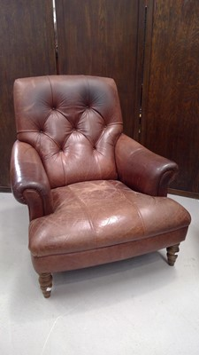 Lot 2 - A leather button back armchair with turned...