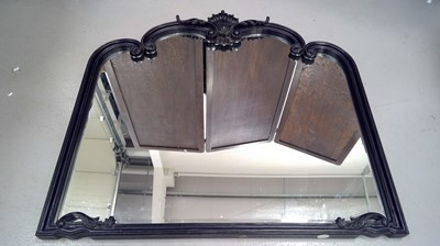 Lot 10 - An ornate wood carved gesso painted overmantle...