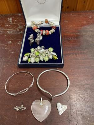Lot 24 - A fully hallmarked silver bangle, a 'Pandora'...