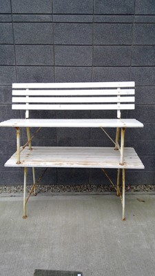 Lot 3 - A garden bench and a matching table width 140cm.